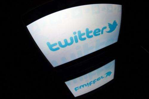 "A picture taken on December 4, 2012 in Paris shows the ""Twitter"" logo on a tablet screen"