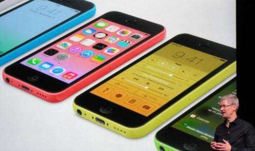 Apple chief executive Tim Cook praises the new iPhone 5S on September 10, 2013 in Cupertino, California