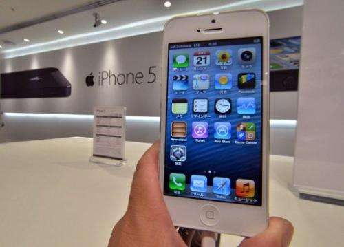 Apple's iPhone 5 smartphone is displayed at the Softbank mobile phone shop in Tokyo on September 21, 2012