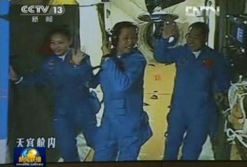 Chinese astronauts (L-R) Wang Yaping, Nie Haisheng and Zhang Xiaoguang in a CCTV frame grab, June 13, 2013