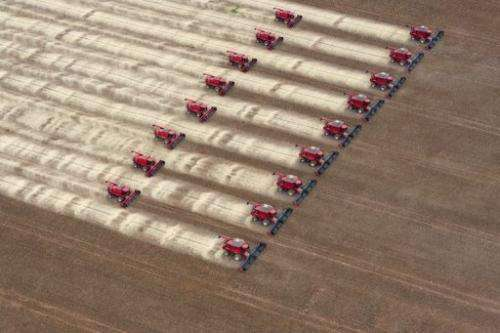Combine harvesters crop soybeans in Campo Novo do Parecis, Brazil, March 27, 2012