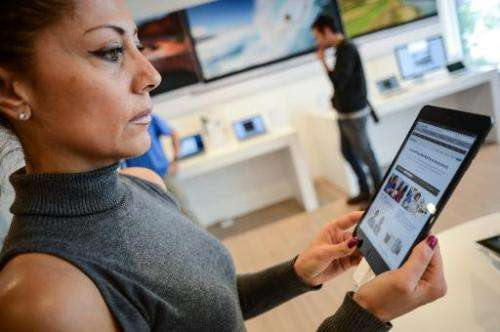 Customers look at the iPad mini at an Apple store in Rome on November 2, 2012