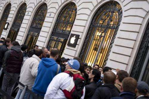 Customers wait to buy Apple's new iPhone 5s smartphone in front of the Apple Store in Paris on September 20, 2013