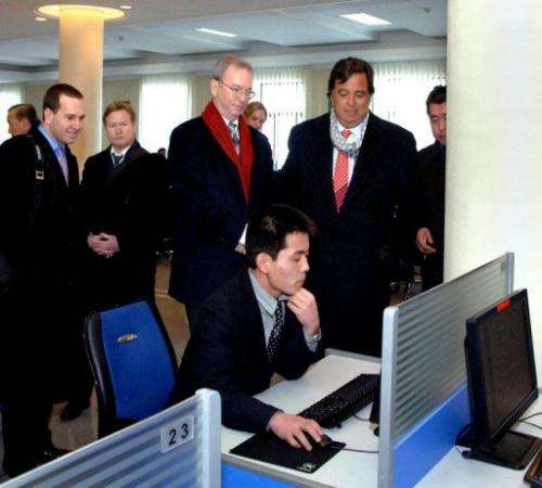 Google chairman Eric Schmidt (3rd L) is pictured on January 8, 2013 visiting an e-library at Kim Il-Sung University