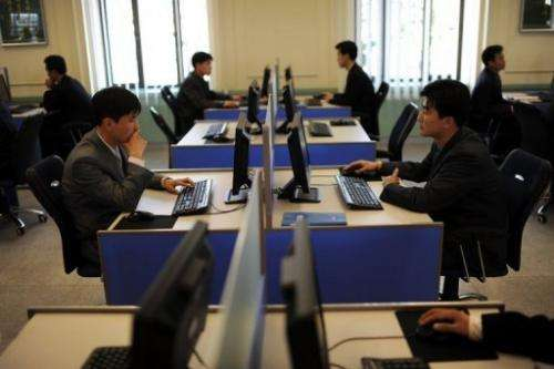 North Korean students work on their computers at Kim Il-Sung University in Pyongyang on April 11, 2012