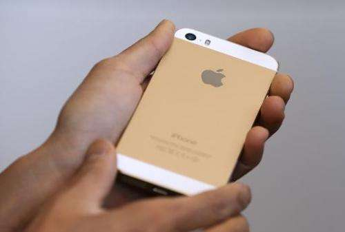 The new iPhone 5S is displayed during an Apple product announcement at the Apple campus on September 10, 2013 in Cupertino, Cali
