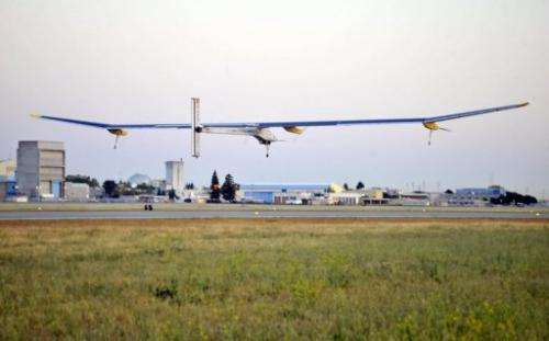 The Solar Impulse plane takes off from Moffett Field in Mountain View, California, on May 3, 2013