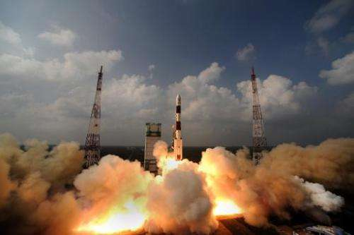 This photo, released by the Indian Space Research Organisation (ISRO) on November 6, 2013, shows the PSLV-C25 rocket carrying th