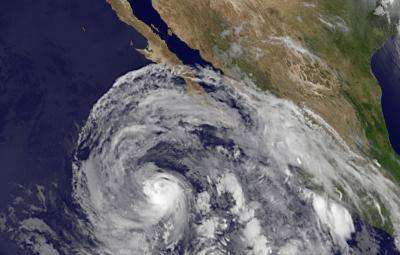 NASA satellites see Eastern Pacific's hurricane Cosme weaken