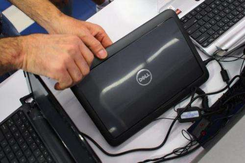 A customer looks at a Dell computer on display at the Electric Avenue store on February 5, 2013 in Miami, Florida