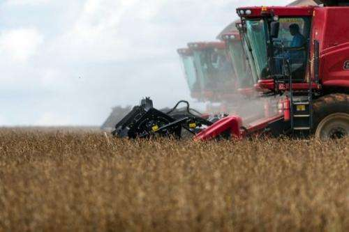 Combine harvesters crop soybeans in Campo Novo do Parecis, Brazil, on March 27, 2012