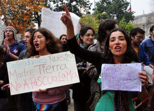 Environmentalists shout slogans against the Pascua Lama mining project in Santiago May 14, 2009