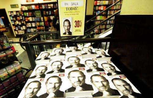 "File picture from New York shows a biography of Apple co-founder Steve Jobs whose boyhood home has been designated an ""hist"