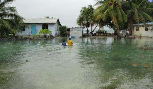 Residents wade through floods in Majuro Atoll, the capital of the Marshall Islands, on February 20, 2011.