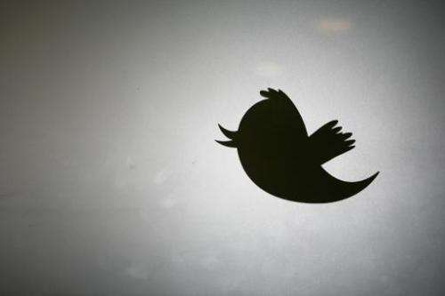 The Twitter logo displayed at the entrance of Twitter headquarters in San Francisco, California on March 11, 2011