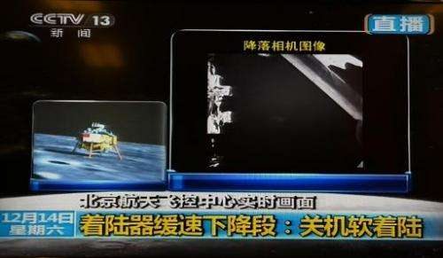 This screen grab taken from CCTV live broadcasting footage shows an image (right) of China's first lunar rover transmitted back