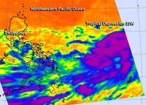 NASA sees tropical depression 22w taking a northern route in northwestern Pacific