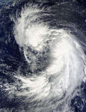 NASA satellite sees 2 vortices circling newborn Tropical Storm Man-yi's center
