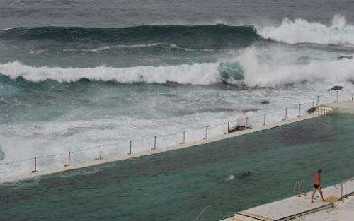 File photo shows huge surf near Sydney's Bondi beach, as study reveals Australian surf kills more people than bushfires, cyclone