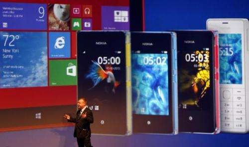 Nokia CEO Stephen Elop unveils products during an event on October 22, 2013 in Abu Dhabi