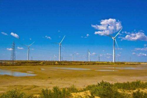 Wind turbines dot the landscape on the outskirts of Dongying, in central China's Shandong province, December 10, 2009
