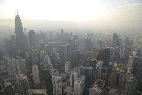 A general view of Kuala Lumpur skyline is seen covered by haze on June 27, 2013
