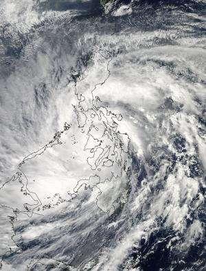 NASA sees Super-Typhoon Haiyan maintain strength crossing Philippines