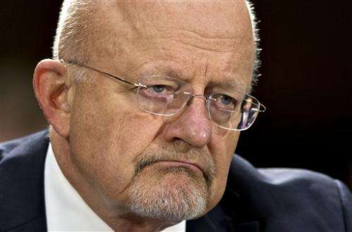 US intelligence chief sorry for 'erroneous' answer