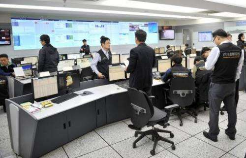 Members of the Korea Internet Security Agency check on cyber attacks in Seoul on March 20, 2013
