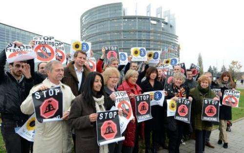 """Members of the European Parliament hold banners reading, """"Stop fracking,"""" November 21, 2012"""