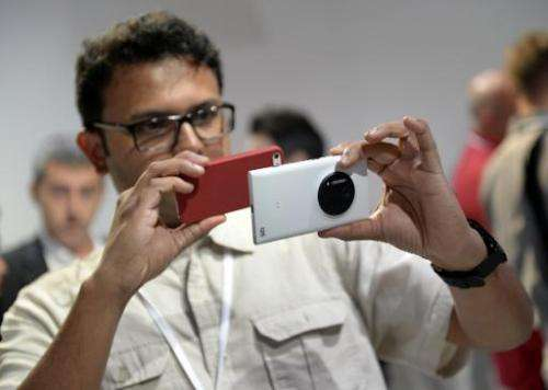 Members of the press takes photos of  the Nokia Lumia 1020, a Windows Phone with a 41-megapixel camera at a event in New York Ci