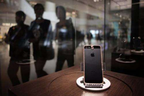 A $25,760 (200,000 HKD) custom-built iPhone 5 with a rose gold dressing, on sale in Hong Kong on April 23, 2013