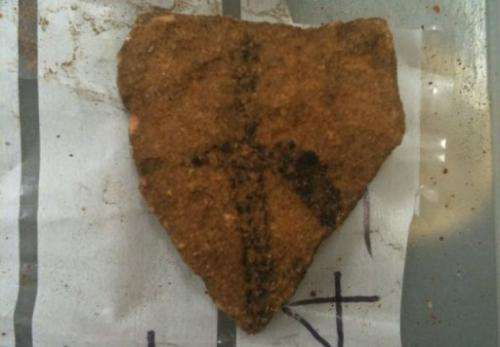 A 28,000-year-old charcoal rock art fragment excavated from Arnhem land in Australia's Northern Territory