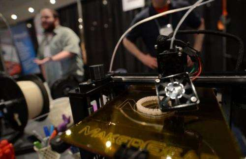 A 3D printer prints an object during an exhibition in New York on April 22, 2013