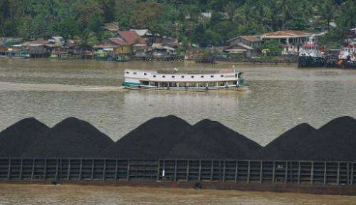 A barge on the river Mahakam ships a cargo of coal from the mining area in Samarinda, East Kalimantan, on November 10, 2013