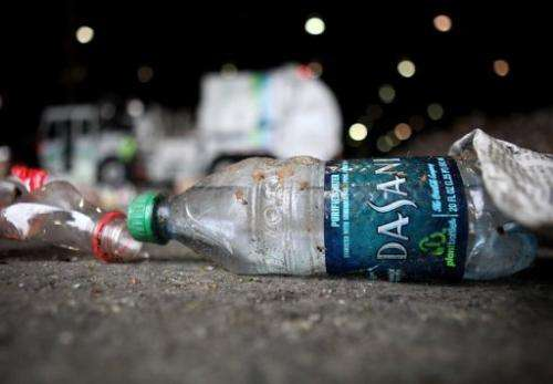 A bottle of Dasani water sits on the floor of a recycling facility in San Francisco, California, on March 15, 2011