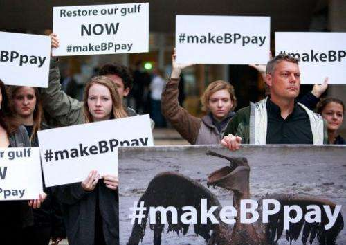 Activists protest on February 25, 2013 outside the building where the BP trial began in New Orleans, Louisiana