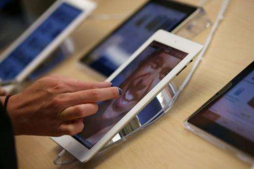 A customer inspects a fourth-generation Apple iPad at an Apple store on February 5, 2013 in San Francisco, California