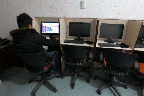 A customer is seen surfing the Internet at a cafe in Tehran, on January 24, 2011