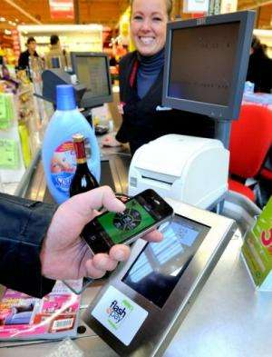 A customer pays via a smartphone application in a Auchan supermarket near Lille, northern France  on December 6, 2012