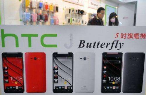 A customer visits a HTC store in Taipei on January 7, 2013