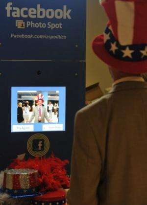 A delegate poses in the Facebook photo booth at the Republican National Convention in Tampa, Florida, on August 29, 2012