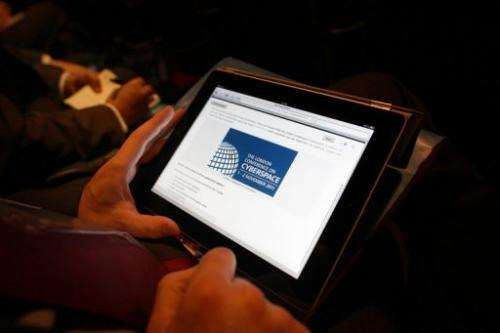A delegate works on a tablet computer at the Conference on Cyberspace in London on November 1, 2011