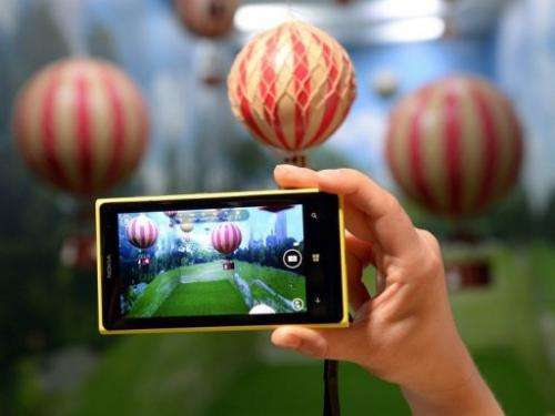 A employee demonstrates the photo capabilities of the Nokia Lumia 1020 in New York City, July 11, 2013