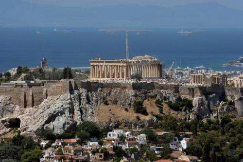 A general view of Athens with the Acropolis rising above the city on June 21, 2012