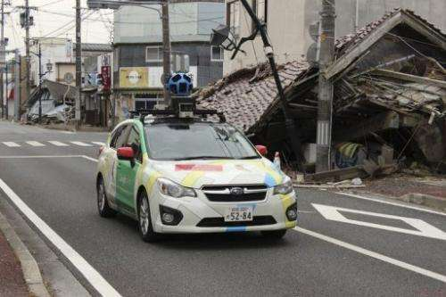 A Google car mounted with a street view camera drives through a street in Fukushima Prefecture in March 2013