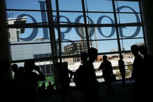 A Google logo is seen through windows of Moscone Center in San Francisco on June 28, 2012