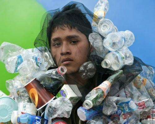 A Greenpeace activist demonstrates in Mexico City on December 3, 2010
