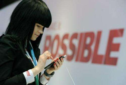 A hostess holds a Huawei smartphone, at the 2013 Mobile World Congress in Barcelona, on February 28, 2013