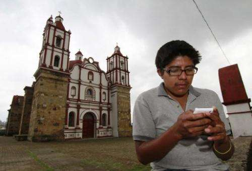 A local resident uses his mobile phone in Talea de Castro in Mexico, on August 17, 2013